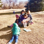 Deyani deydreaming —reading to a group of children— poop a book about going big potty